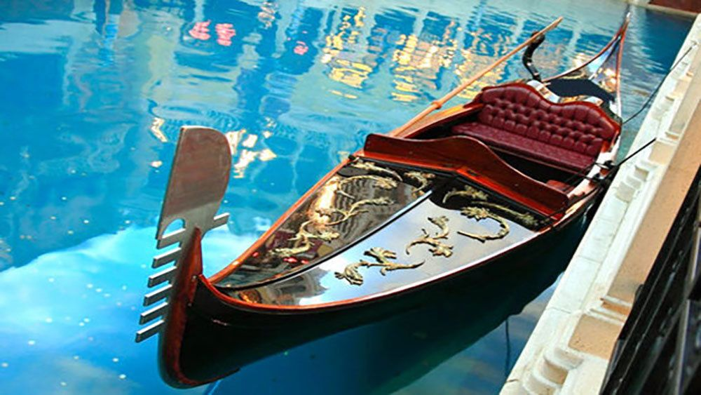intricate detail of gondola upon calm water