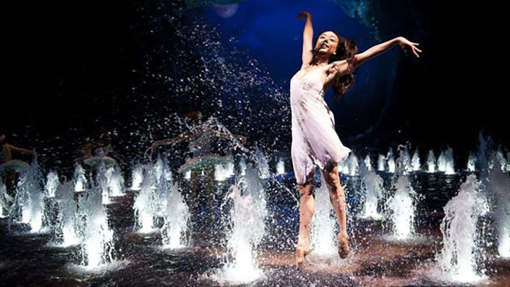 Tampilkan item 1 dari 5. woman dancing amidst many water fountains.