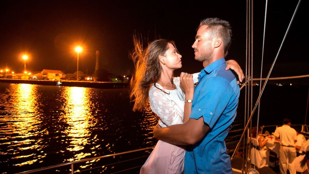Tampilkan item 1 dari 5. Couple dancing aboard a boat on a night cruise of Bali Hai