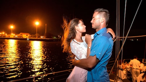 Couple dancing aboard a boat on a night cruise of Bali Hai