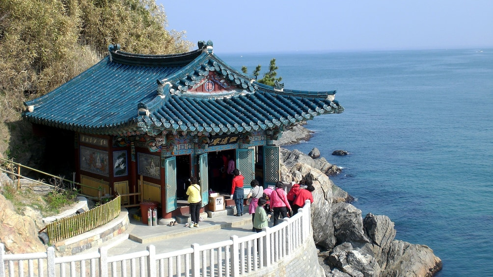 Show item 3 of 5. Traditional Korean shrine overlooking the ocean in Seoul
