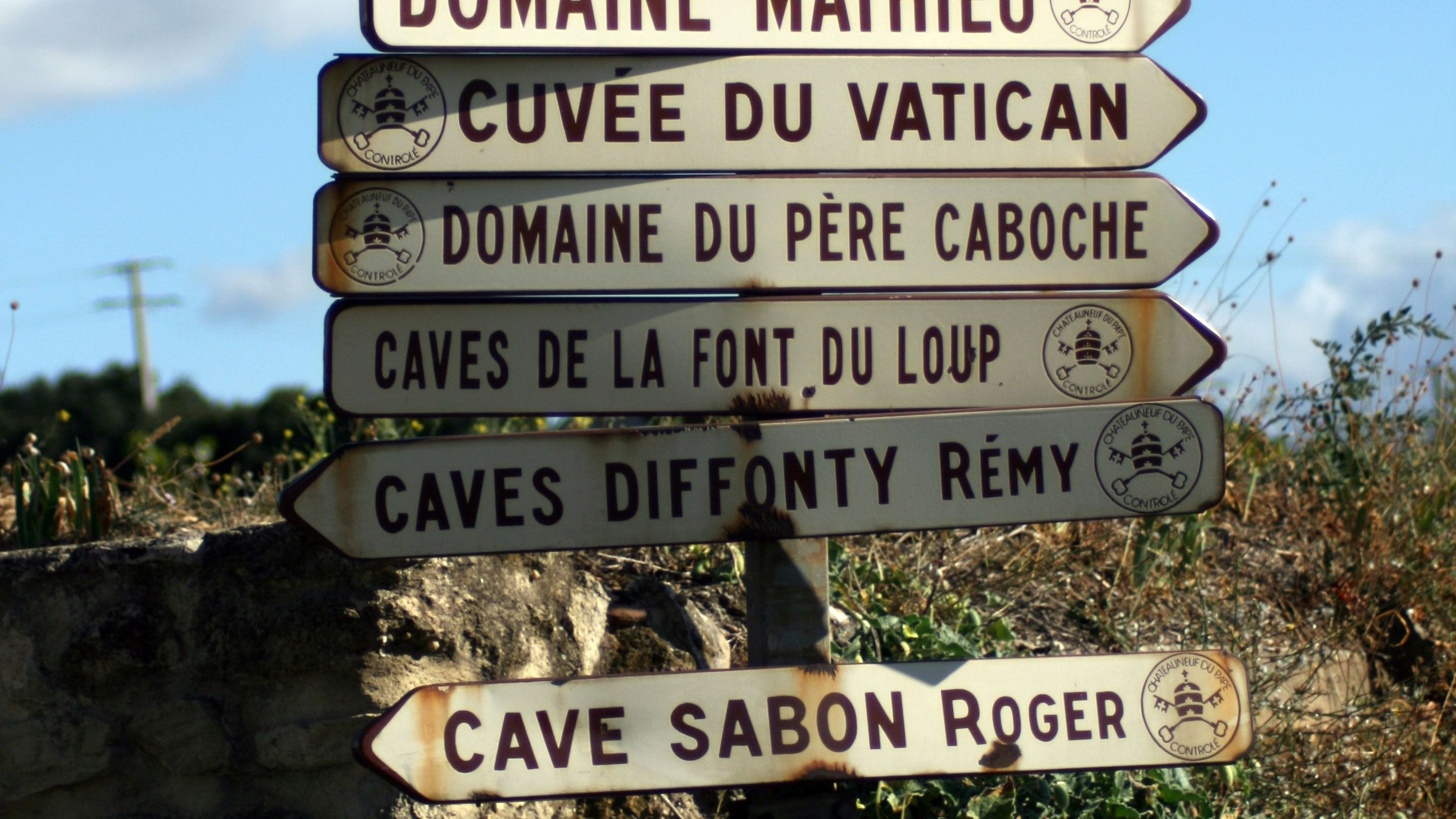multiple street signs in chateauneuf du pape, Marseille