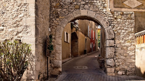 stone archway into village street in Bormes in Marseille