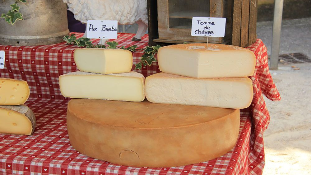 wedges of cheese at open air market in Marseilee