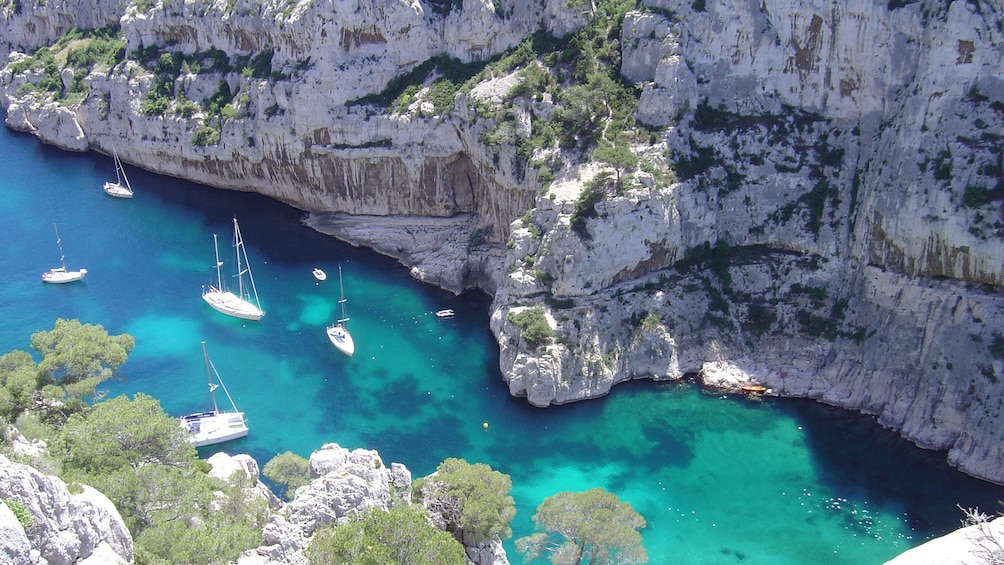 Show item 3 of 8. sailboats anchered in water in The coast of Provence Marseille