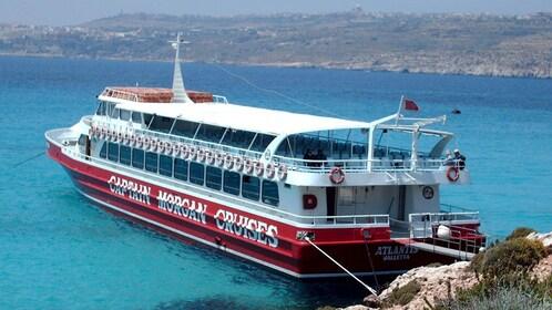 Captain Morgan cruise boat anchored on Comino Island