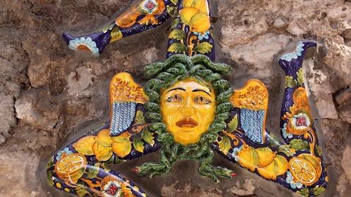 Symbol of Sicily in typical Sicilian glazed ceramic in Taormina