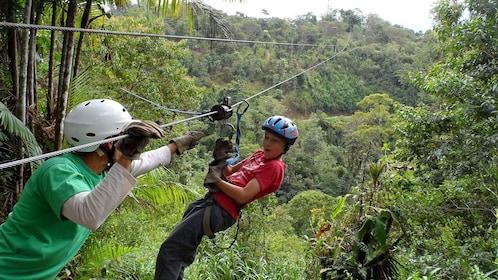 Ziplining woman in the forest of Iguazu.