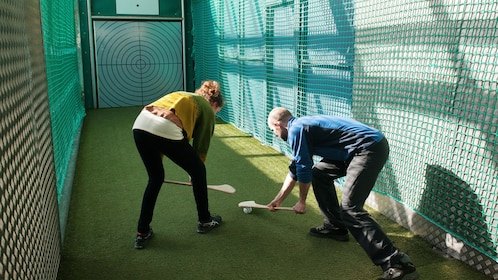 Couple playing a Gaelic game at the Croke Park Stadium & GAA Museum in Dubin Ireland.