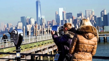 Show item 2 of 9. Looking at the Statue of Liberty from pay binoculars