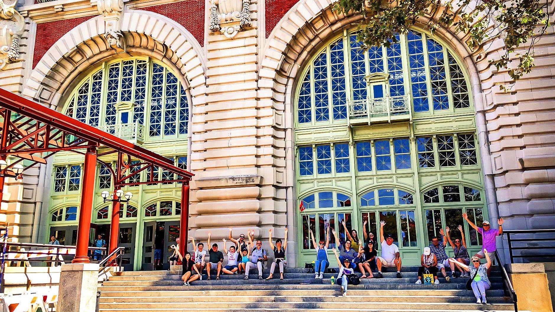 Tour group on steps of Ellis Island
