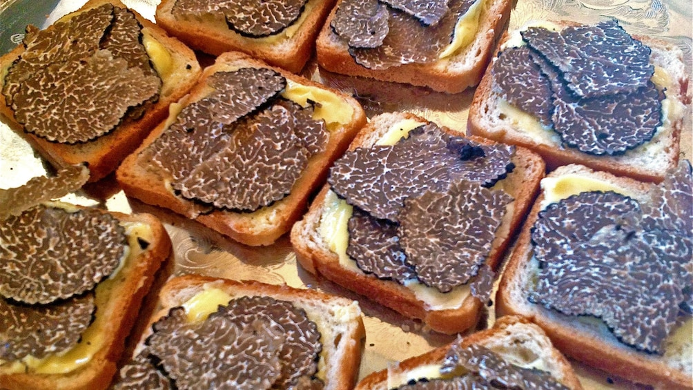 Show item 3 of 7. Sliced truffle on bread in France
