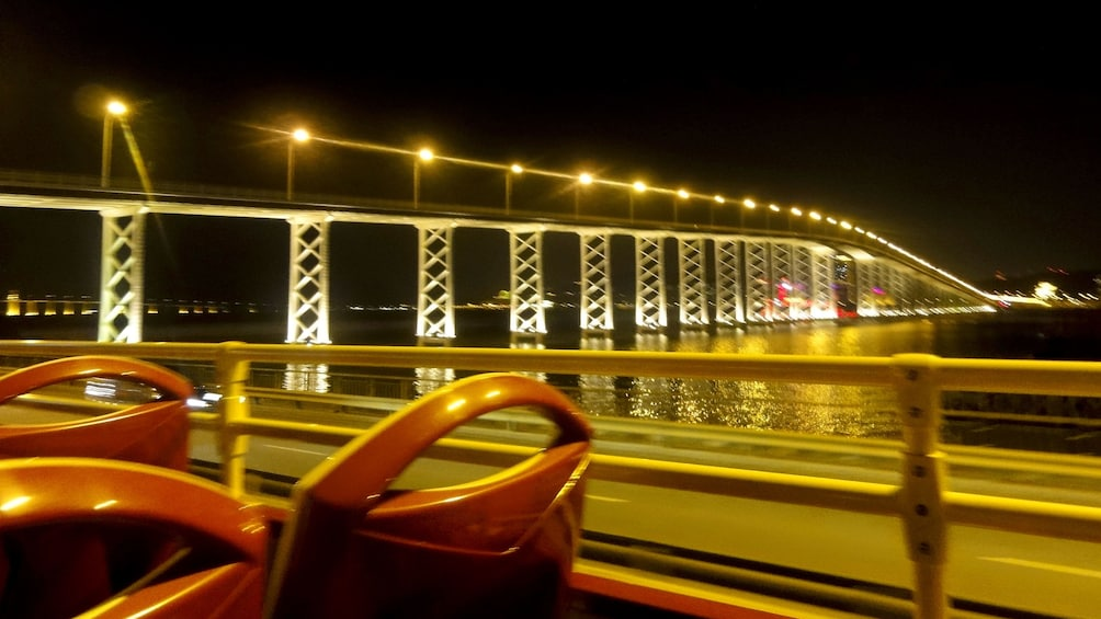 Tampilkan item 5 dari 5. Driving past a Macau bridge at night.