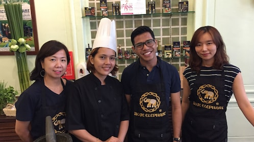 Group posing for picture in Thai cooking class in Bangkok