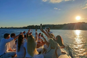 Sunset on board a 9 metre boat with a glass of cava
