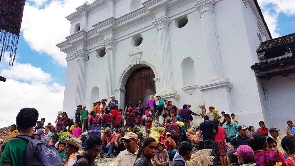 Show item 1 of 8. View outside of cathedral in Chichicastenango market in Guatemala
