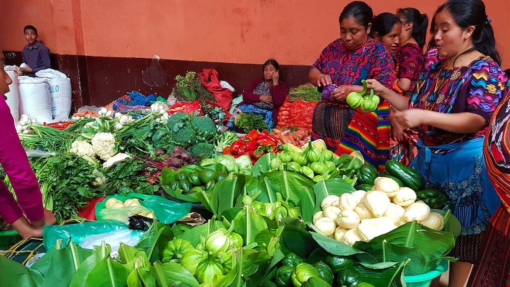 Show item 8 of 8. Large spread of fresh vegetables in Chichicastenango market in Guatemala