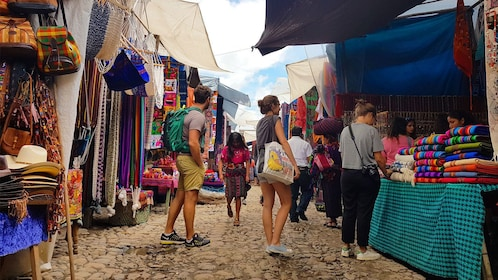 People looking at vendors in Chichicastenango market in Guatemala
