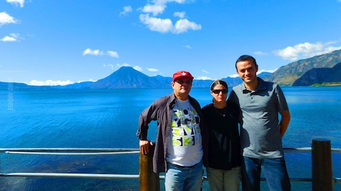 Family has picture taken in front of Lake Atitlan