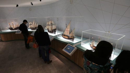 small group of people examine displays at museum in Porto