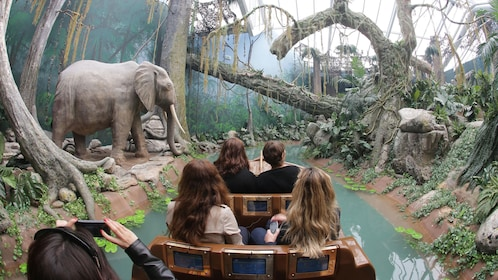 tour group on ride through rain forrest habitat at theme park in Porto