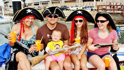 family of five wearing pirate hats aboard sailboat in Los Cabos