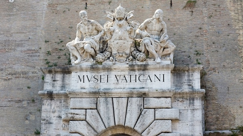 Statues resting over the entrance to the Vatican