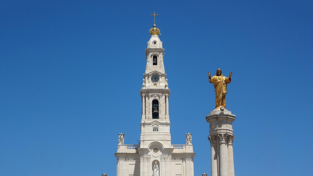 Shrine of Fatima steeple, and gold statue