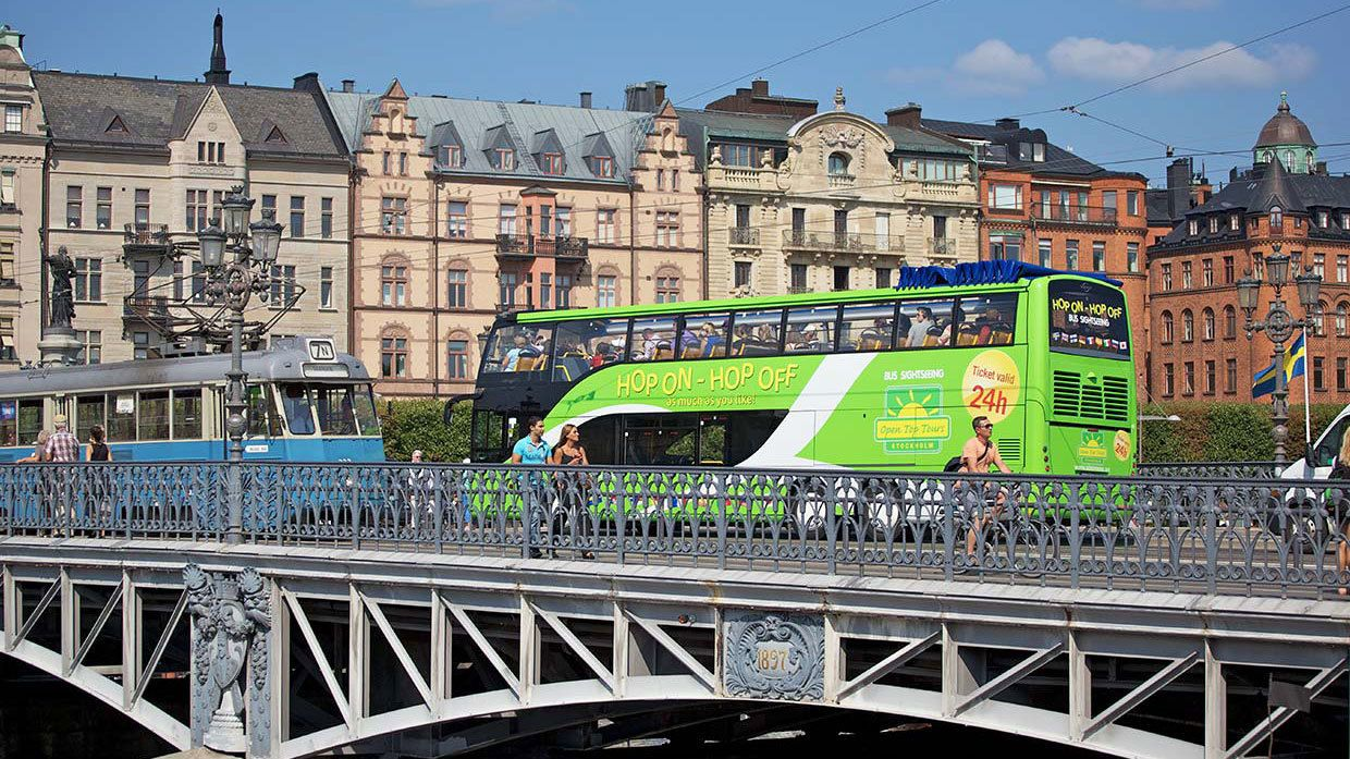 Hop-On Hop-Off bus on a bridge in Stockholm