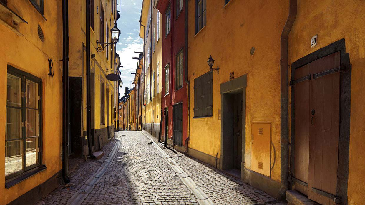 Old Town cobblestone street and yellow buildings in Stockholm