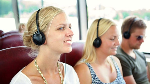 Cruise passengers listen to audio commentary in Stockholm