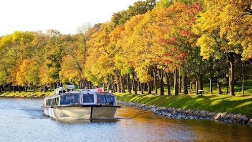 Sightseeing cruise on a tree-lined canal in Stockholm