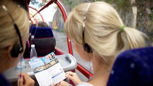 Tour bus passengers consulting a brochure in Stockholm