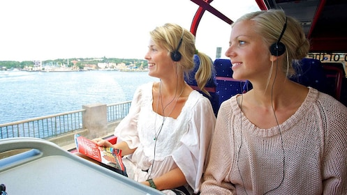 Tour bus passengers look out the window at Stockholm