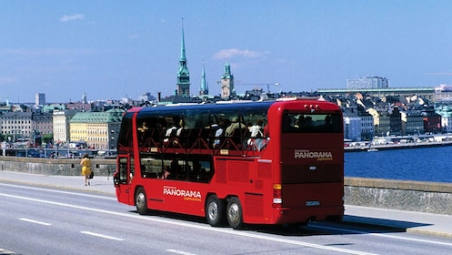 Sightseeing tour bus on the road in Stockholm