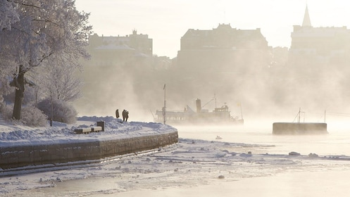 Snow-covered quay along the water in Stockholm