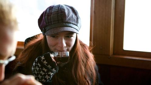 Young girl sipping a hot beverage