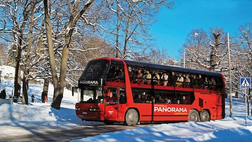Tour bus with passengers in the snow in Stockholm