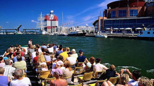 View of Gothenburg from a Hop-On Hop-Off boat cruise with passengers