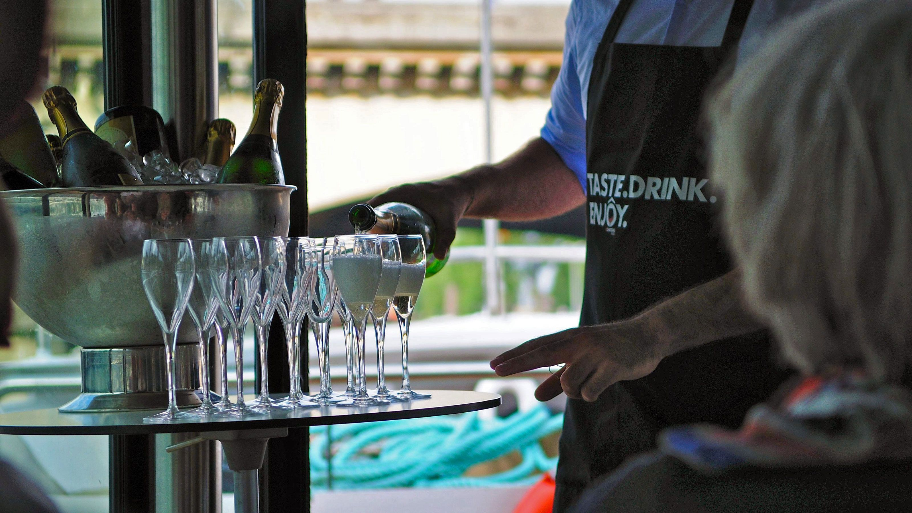 Serving champagne on a river cruise in Paris