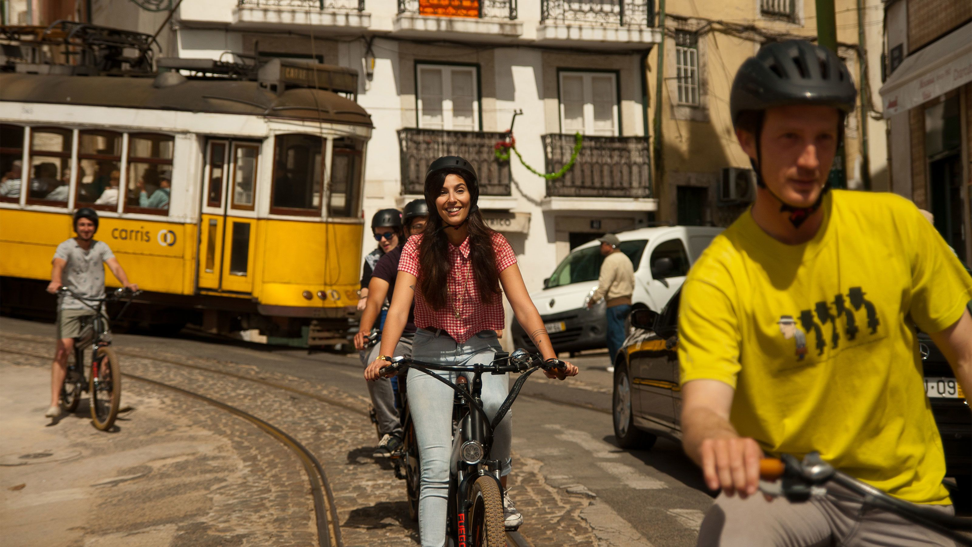 Bicycling group on the street in Lisbon