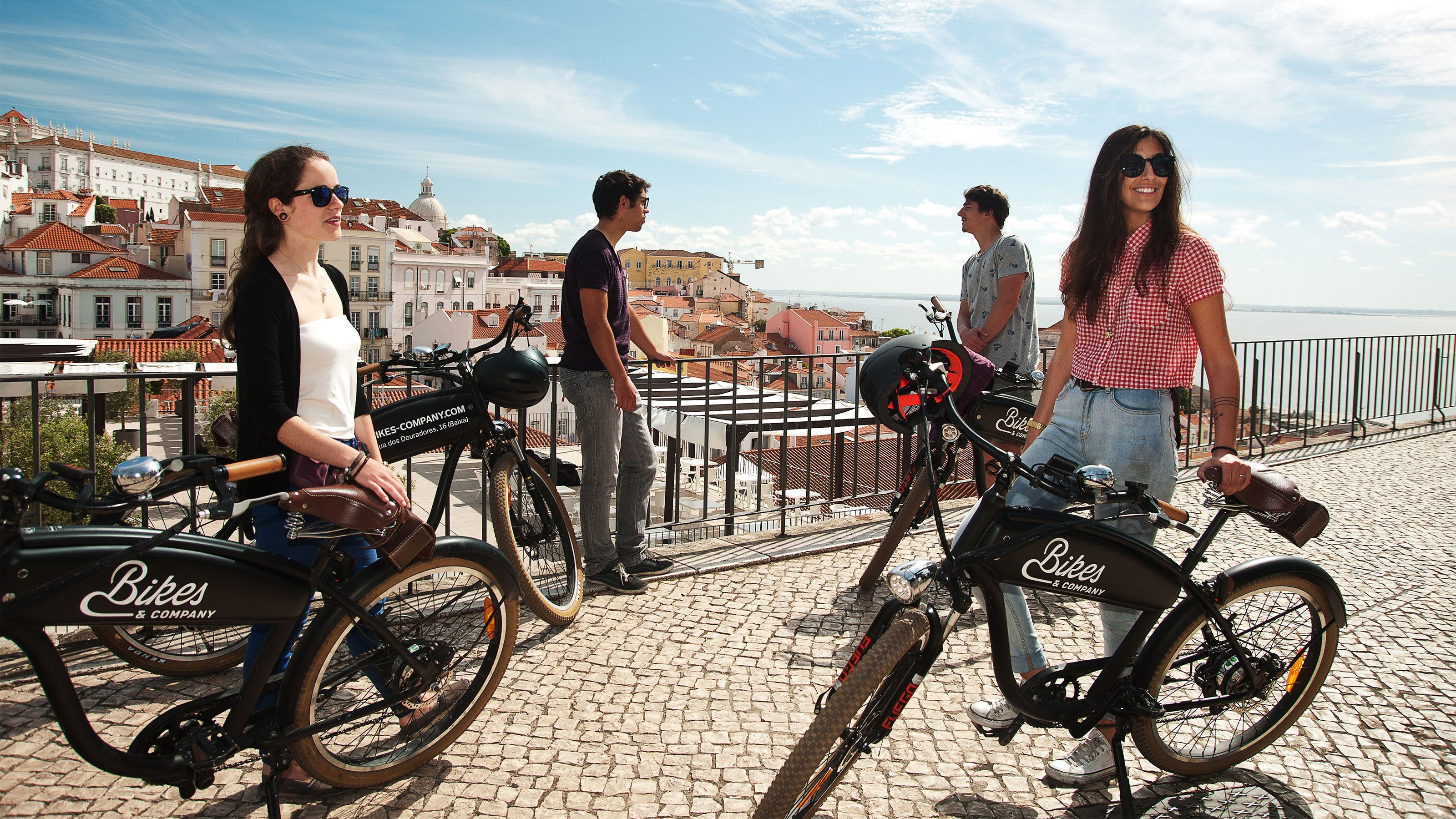 Bicycling group at a scenic viewpoint in Lisbon