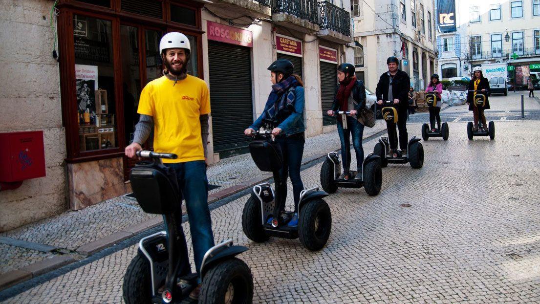 Segway group on cobblestone street in Lisbon