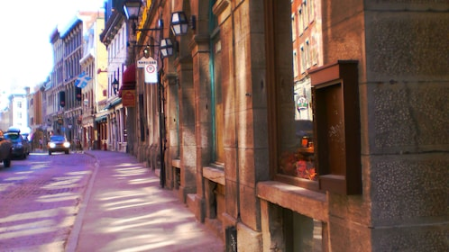 historic buildings line a street in montreal
