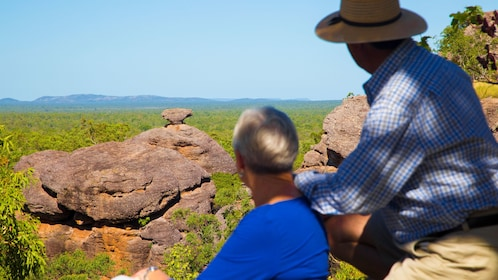 Two people looking out at unique rock formations at Kakadu national park