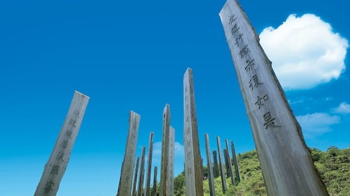 Tall wood pillars engraved with Chinese characters in Hong Kong.