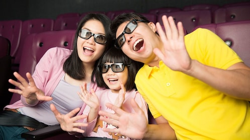Family watching a 3D show in a theater in Hong Kong.