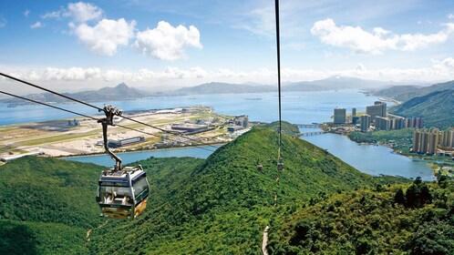 Cablecar descending on a mountain in Hong Kong.
