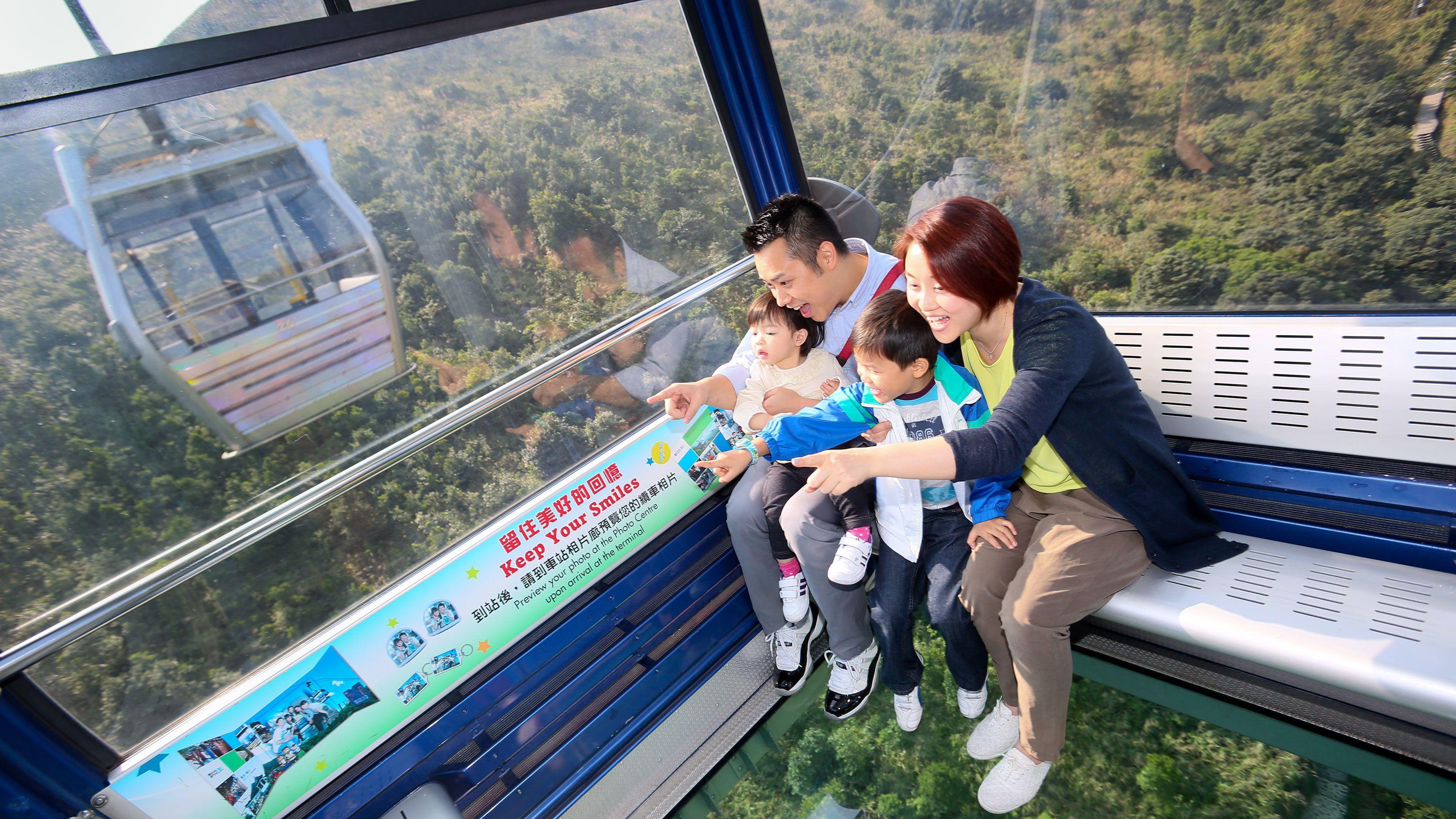 Family enjoying a cablecar ride.