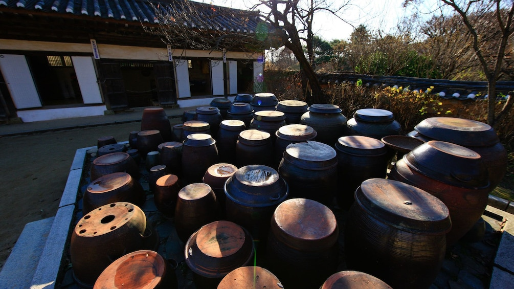 Barrels outside a traditional style building at a Korean Folk Village